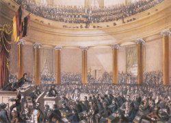 Sitzung der Nationalversammlung in der Frankfurter Paulskirche im Juni 1848, kolorierte Zeichnung von Ludwig von Elliott, 1848. Foto: Wikipedia, File: Frankfurt Nationalversammlung 1848.